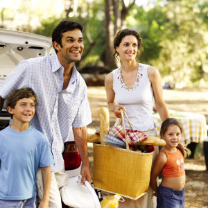 Family Standing Behind a Car at a Picnic Spot