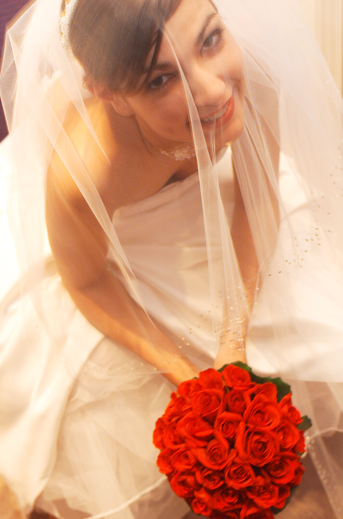 Bride in Veil with Red Rose Bouquet